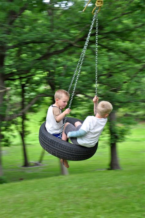 swinging in the backyard diy tire swing memes