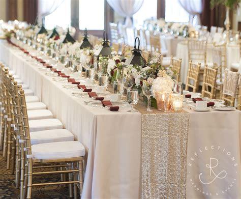 Ivory, blush, gold and burgundy wedding decor on long