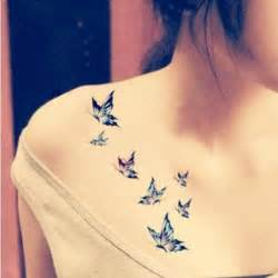 small flying butterflies tattoos on chest