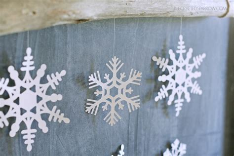 How To Make Hanging Paper Snowflakes - snowflake wall hanging