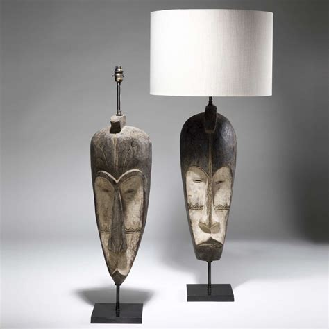 Contemporary Home Interiors pair of large brown african tribal mask lamps on bronze