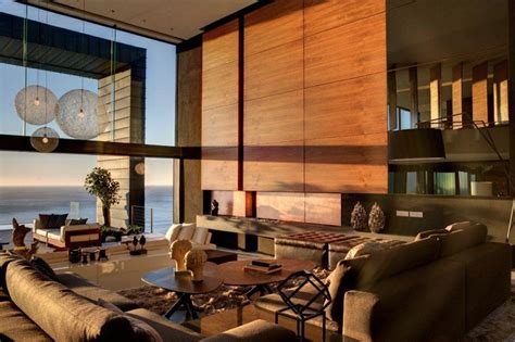 neutral wood panel living room sea view interior design