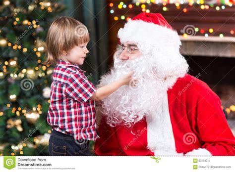 libro father christmass fake beard surprised little boy looks at fake santa claus stock image image 63193317