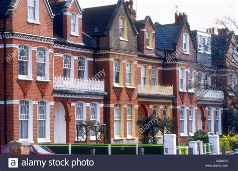 houses to buy in west london edwardian terraced houses in tooting west london showing wrought iron stock photo