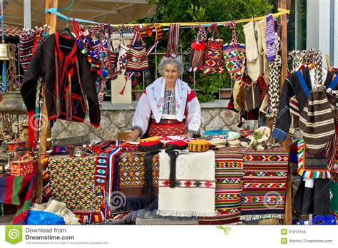 in traditional clothes selling on booth editorial