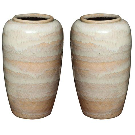 large pair of highly decorative glazed pottery vases at