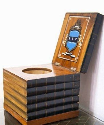 toilet hidden in a stack of books neatorama
