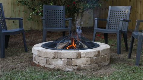 how to make a simple fire pit in your backyard how to build a backyard fire pit from a kit today s homeowner