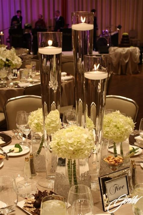 candles for centerpieces for wedding receptions vases with floating candles embellished with white hydrangea wedding reception