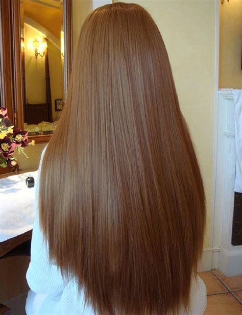cutting hair so it curves under straight brown waist length curve cut strong thick and
