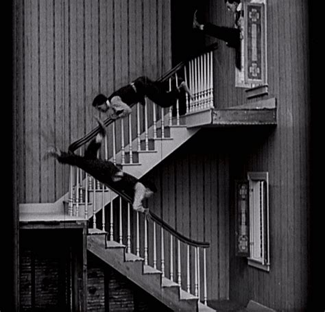 sliding down banister neighbors gifs wifflegif