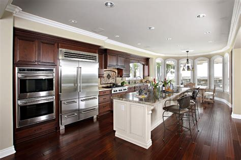 island kitchen and bath cabinets with white island in laguna niguel ca