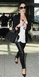 Victoria Beckham in tight leather trousers as maternity