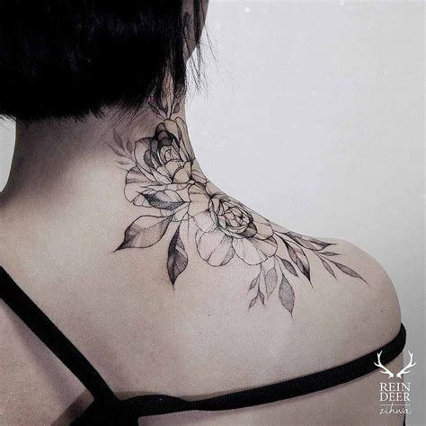 rose on neck tattoo on neck piercing ideas