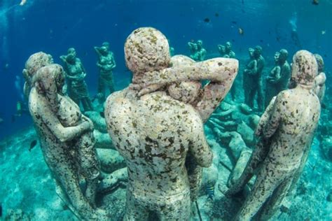 dive gili islands underwater statues near gili air two fish divers