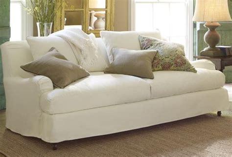 white slipcovered sofa beautiful pottery barn