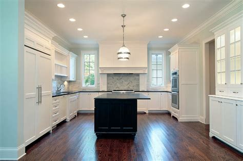 white kitchen cabinets with black granite countertop