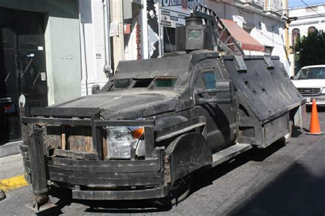 armored jeep after an attack by mexican cartel geopolitics analysis latin america and the zombie factor