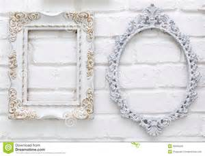 vintage picture frames on white brick wall royalty free