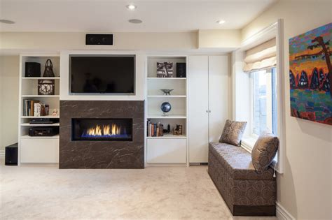 basement built in unit with gas fireplace and storage