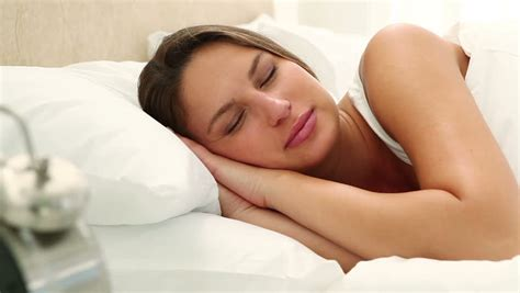 how to get her in bed happy woman goes back to sleep in her bed stock footage