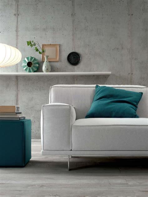 white sofa and emerald green cushion and