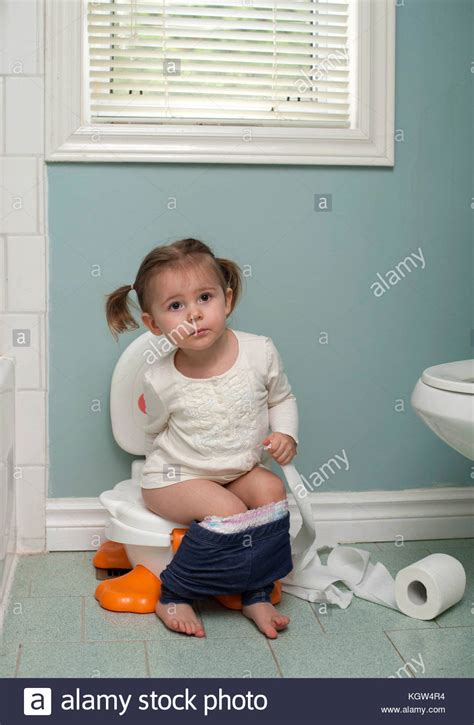 girl on toilet potty training young girl sitting on toilet stock photos young girl