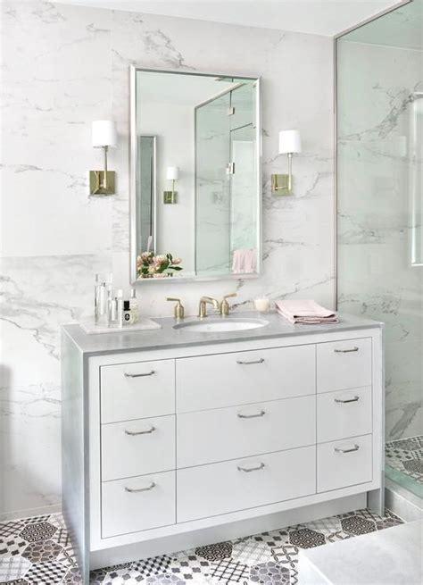 white washstand with gray waterfall countertop
