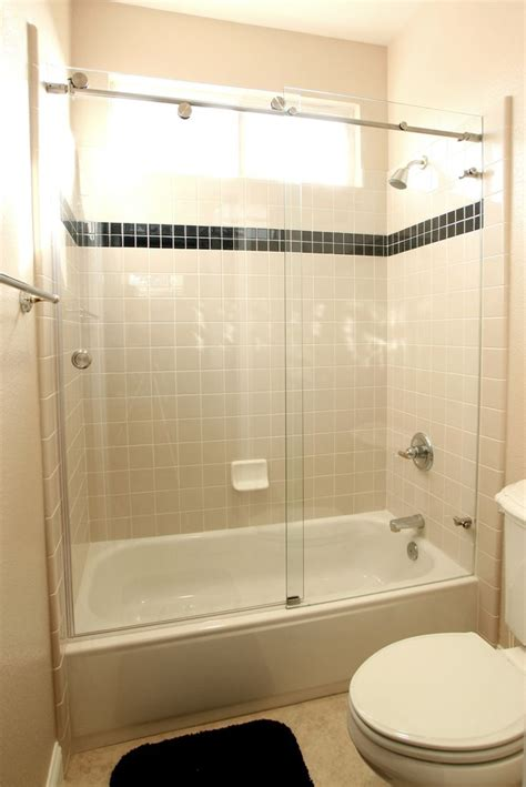 shower stall bathtub exposed roller sliding door over tub shower letting the