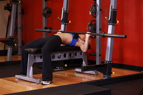 women bench pressing wide grip barbell bench press exercise guide and video