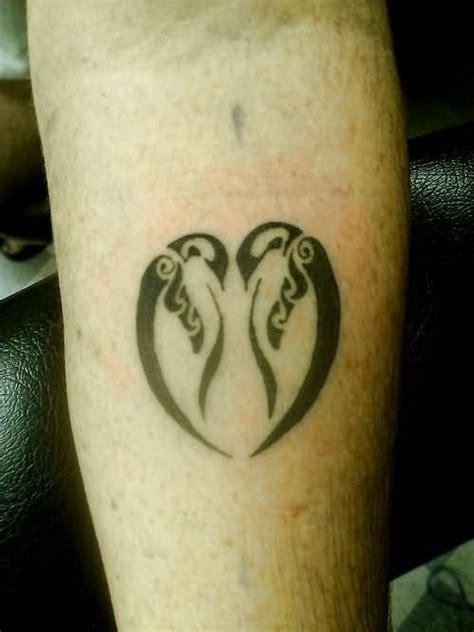 tribal penguin tattoos black penguin tattoos on hips