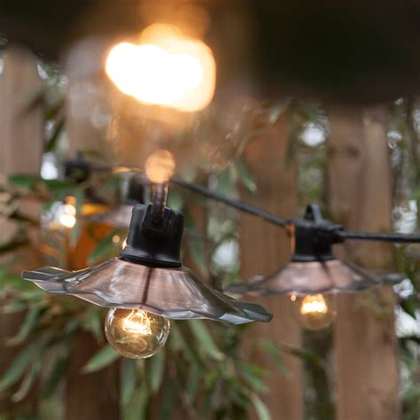 Outdoor Cafe Lights Create A Backyard Cafe With Bistro Lights Yard Envy