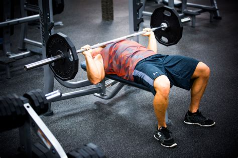 dumbbell bench vs barbell back to basics bettering your bench press cast iron