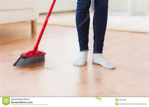 Sweep Floor by Up Of Legs With Broom Sweeping Floor Stock