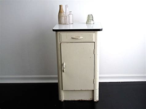 how to enamel cabinets vintage white metal cabinet with an enamel top via etsy