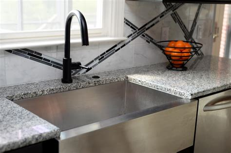 black stainless steel farmhouse sink stainless steel farmhouse sink with black faucet hgtv