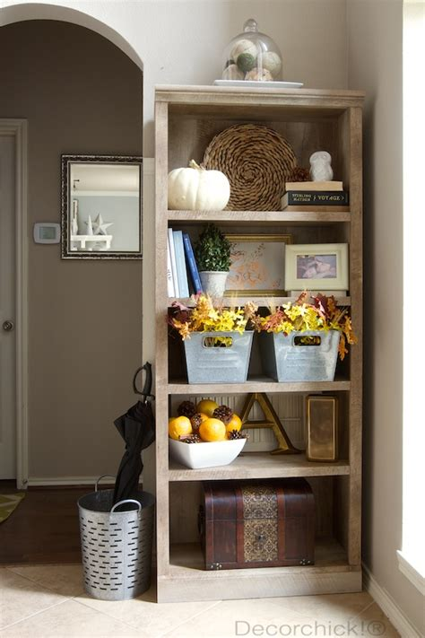 fall entryway and new bookcase decorated for the season