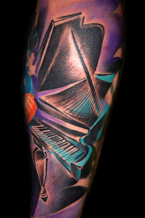piano tattoo by bugs tattoomagz