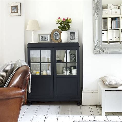 Black Cabinet For Living Room by White Living Room With Black Cabinet Decorating