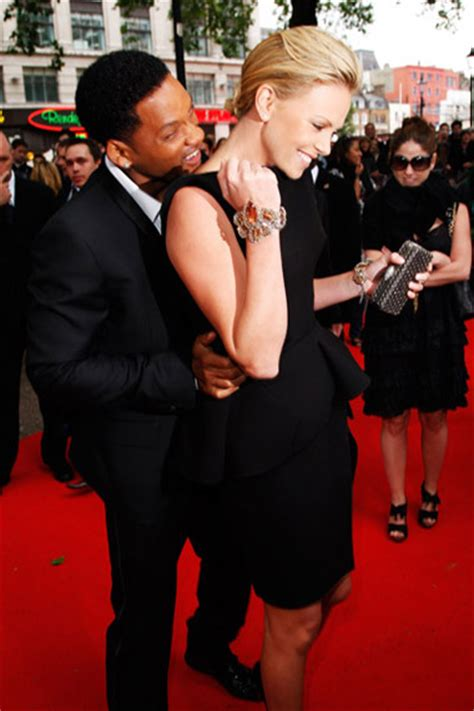 Could Charlize Theron Play Smith In Biopic by Will Smith Nuzzles Charlize Theron S Neck At Hancock Premiere
