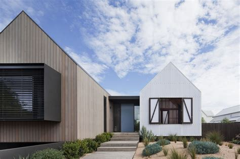 seaview house s pavilions fit in with its weatherboard