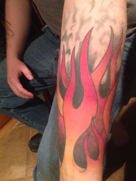 up in flames tattoo another angle of his flames forearm