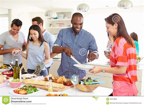 group friends having dinner party at home stock images