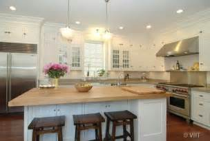 White Kitchen Island With Butcher Block Top by White Kitchen Cabinets Cottage Kitchen
