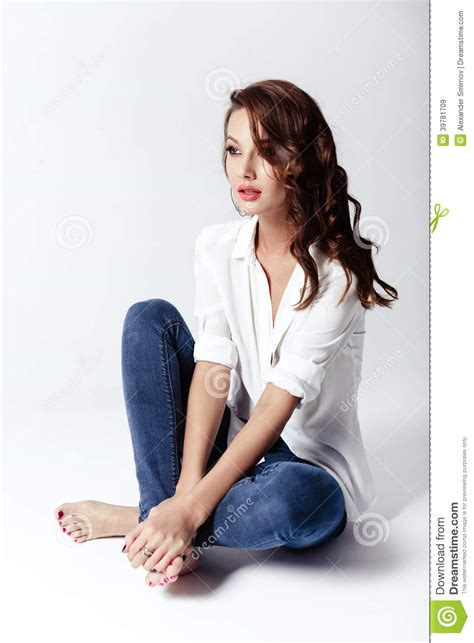 Business Floor Plan by Fashion Model In A Blouse And Jeans Barefoot Stock