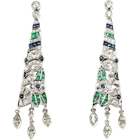 a 20s diamonds emeralds and sapphire earrings from