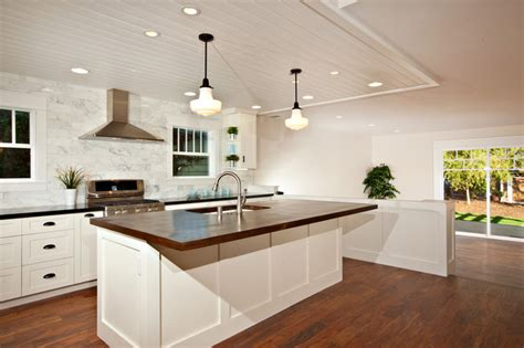 white kitchen wood island white kitchen with wood island carrara backsplash black