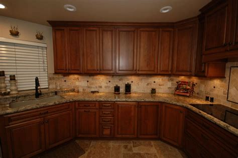 cherry cabinets with quartz countertops starmark cherry cabinets with harvest stain and chocolate