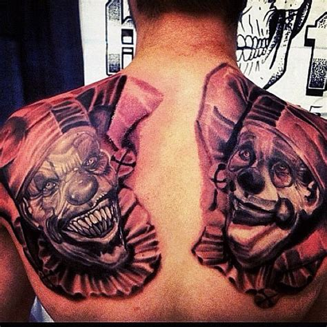 massive realistic creepy and funny clown tattoo on back