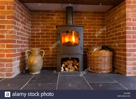 Brick Fireplaces For Wood Burning Stoves by In Wood Burning Stove In Brick Fireplace With Basket